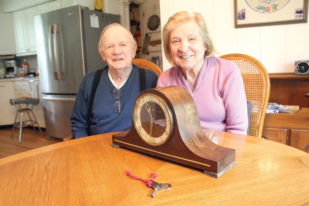 FULL CIRCLE: Howard and Stephanie O'Brien with the clock that was stolen from their home 42 years ago.