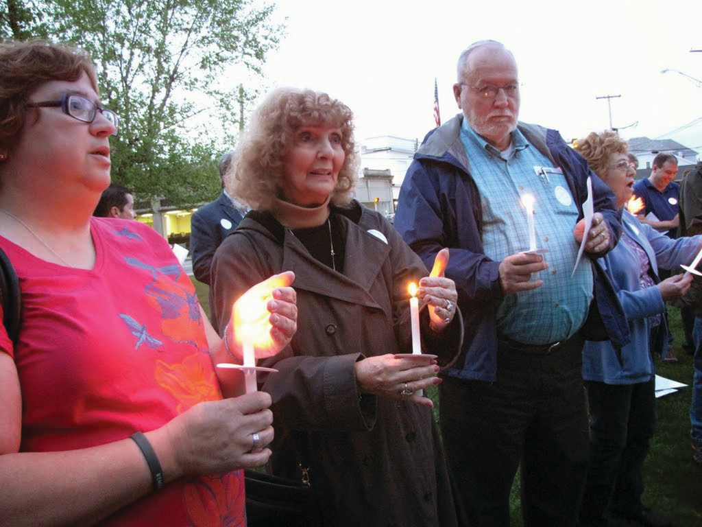 FINDING THE LIGHT: Almost 75 people attended Monday night's candlelight vigil for Joseph Graham, who passed away in early April. He was living outside at the time of his death. During the vigil, advocates urged for support of programs to end homelessness.
