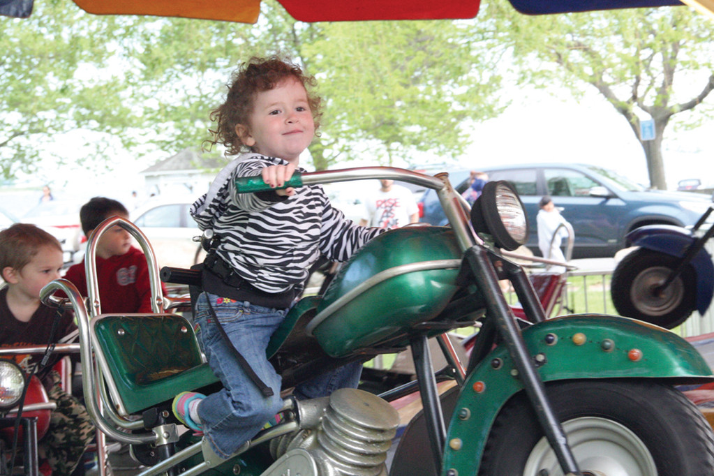 EASY RIDER: Avery Jones, who is 2-and-a-half years old, is in command of her motorcycle.