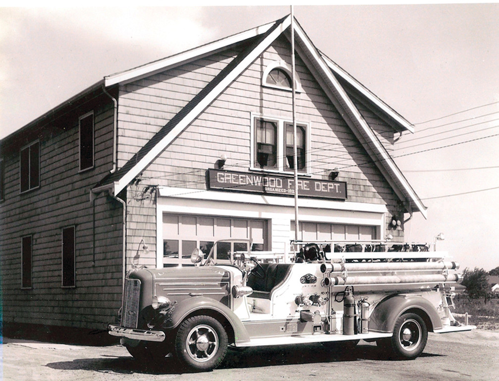IN ITS HEYDAY: The new 1940 Mack Truck is pictured outside the Greenwood Fire Station soon after its purchase. The truck can hold two occupants in the cab and up to 12 men in various stations along the side and back.