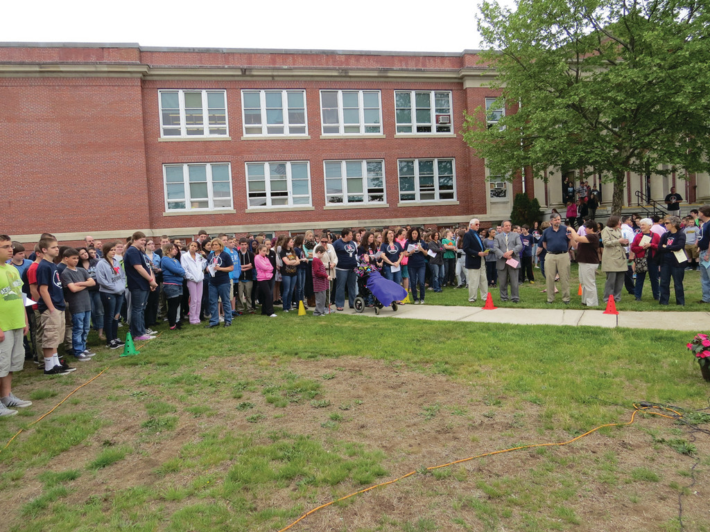 STANDING STRONG: The students at Aldrich Junior High gathered outside on Friday morning for a brief ceremony to honor former phys. ed. teacher Martha Whitaker, who passed away last September. Many wore M Strong, �Martha Strong� T-shirts, created last year as a fundraiser for the American Cancer Society.
