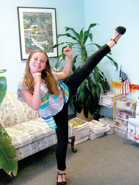 KICK AND SMILE: Grace Rotondo shows off her high kick with little effort and a big smile.