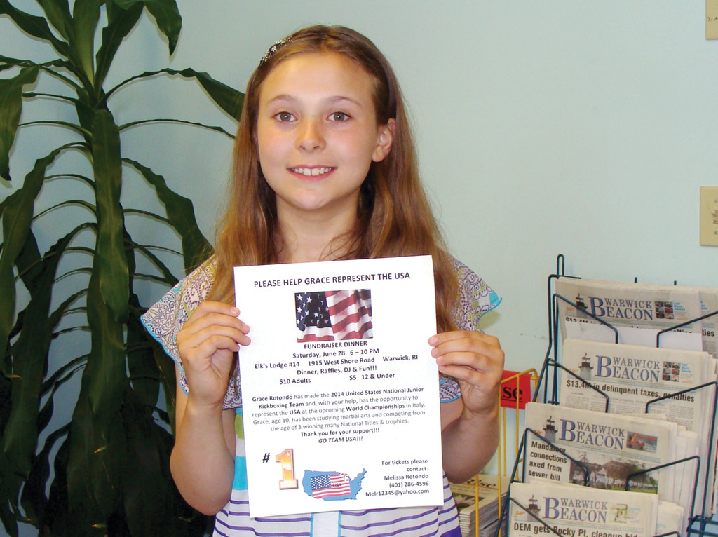GRACE: The 10-year-old holds the flyer for the fundraiser dinner that will hopefully help Grace and her family travel to the World Championships for Kickboxing in Rimini, Italy.