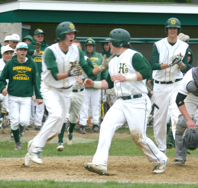 RELIEF: The Hendricken baseball team celebrates as John Toppa crosses the plate with the winning run in last week's playoff opener against Middletown. The Hawks escaped the Islanders 3-2 then shut out Lincoln 5-0 for a spot in the regional final.