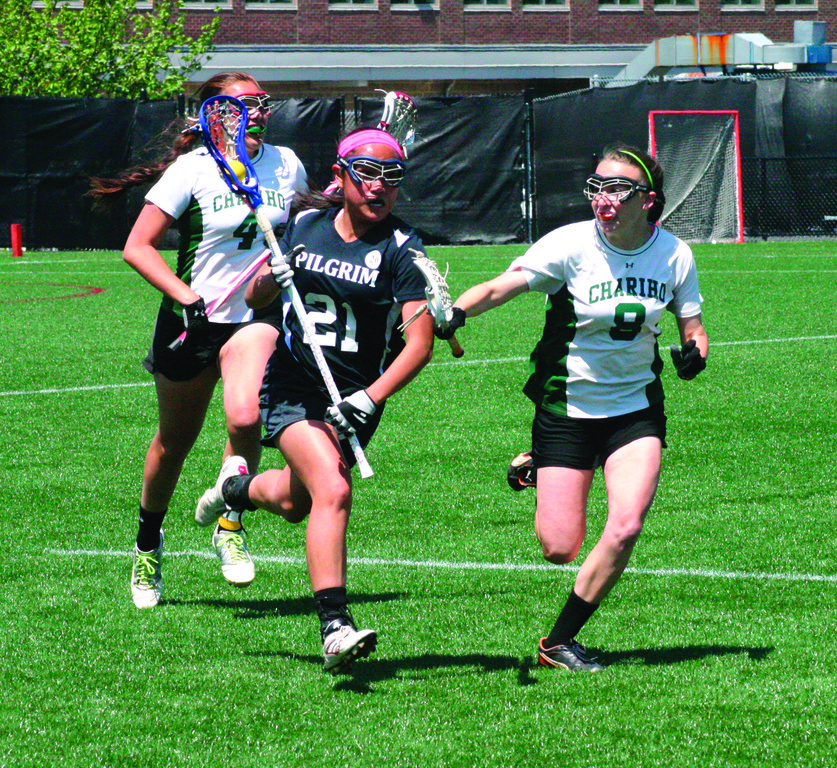 TOUGH END: Clare Birney heads up the field in Saturday�s Division III lacrosse championship. Chariho rallied from a five-goal deficit to beat Pilgrim.