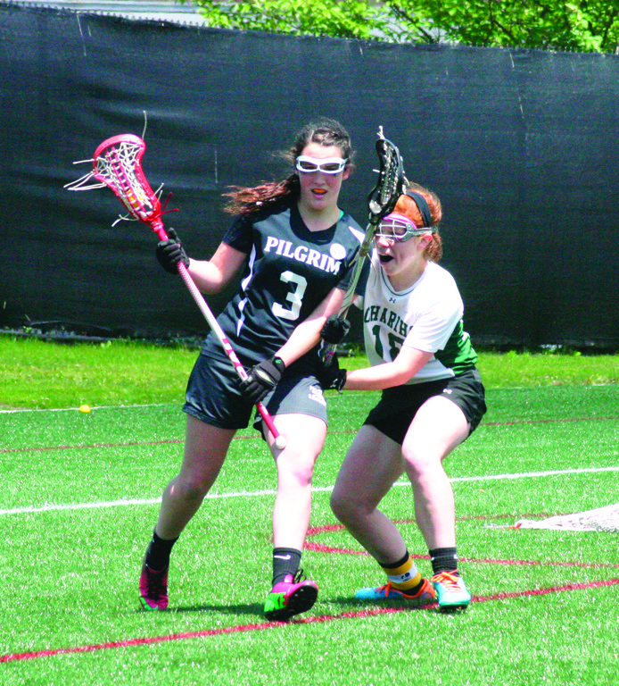Sophia DeLuca tries to turn the corner on a Chariho defender.