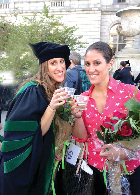 A TOAST: Gianna, left, and Elaina Petrone share a toast to their achievements during Gianna�s graduation from the University of New England�s College of Osteopathic Medicine.