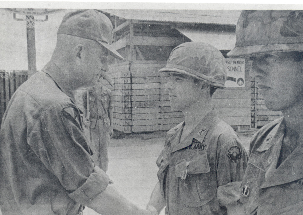 FOR VALOR: U.S. Army First Lieutenant Francis X. Flaherty receives the Bronze Star for Valor during ceremonies at Tan Tru in Vietnam in a photograph originally published in the Warwick Beacon in 1970. Flaherty was serving as a platoon leader with the 2nd Battalion 60th Infantry. Commander Col. Andrew J. Gatsis, who is seen congratulating Flaherty, died in a helicopter crash soon thereafter.