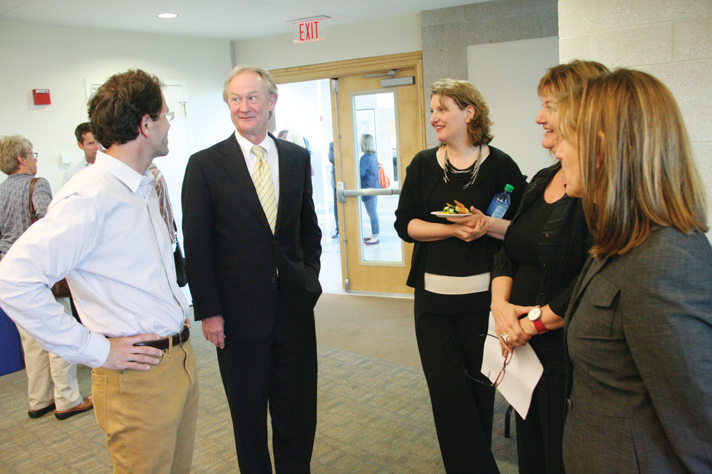 ROCKY POINT PLANS: Governor Chafee chats with George Shuster of the Rocky Point Foundation at Monday�s presentation by RISD students at Save the Bay offices at Fields Point.