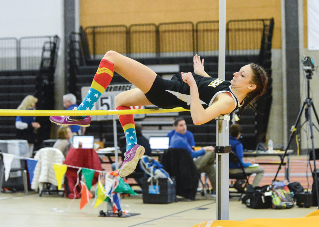 GOING UP: Pilgrim's Melanie Brunelle clears the bar in the high jump during the indoor track season. Pilgrim's  jumpers have continued to shine in the outdoor season.