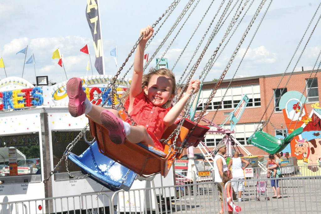 Kylie Bowen, 7, took to the air Sunday during the St. Kevin Church Carnival. The even raised about $5,000, but says Father Robert Marciano, more than that it brought together the parish and instilled a �spirit of community.�