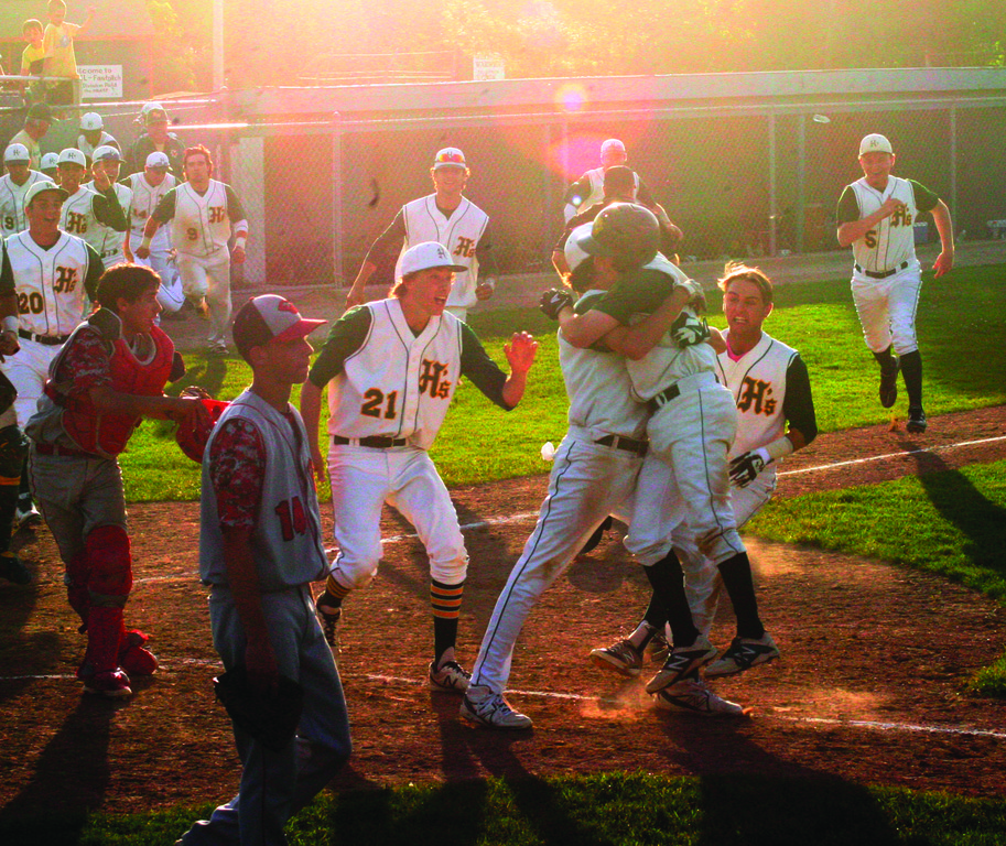 Hendricken players converge on home plate after the winning run scored in Sunday's Final Four game against Cranston West.