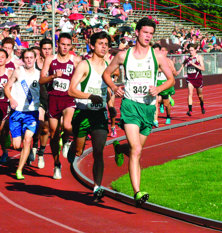 HEAD OF THE PACK: Colin Tierney and Michael Potter lead the charge in the 3,000 at Saturday's state meet. Tierney was one of three Hawks to take a first-place medal.