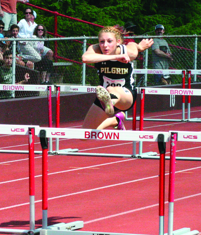 Pilgrim's Melanie Brunelle clears a hurdle on Saturday.