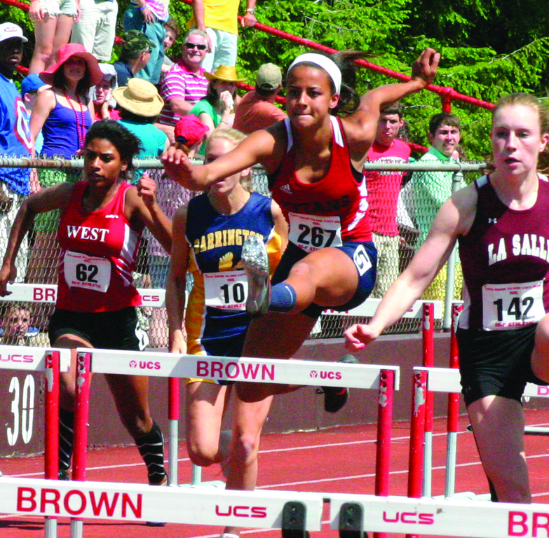 OVER THE TOP: Erika Pena clears a hurdle on her way to a third-place finish for Toll Gate.