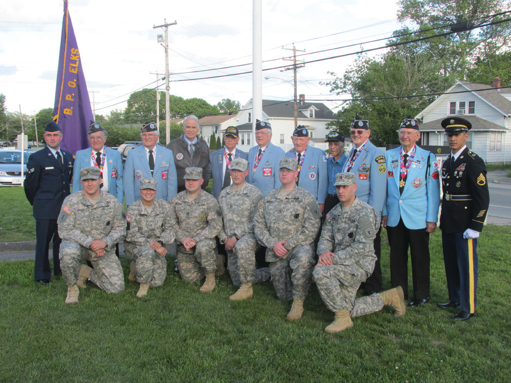GATHERED IN APPRECIATION: While there were 200 past and present military at last Friday�s Veterans Appreciation Day celebration in Warwick, the uniformed soldiers are joined by retired Lt. Gen. Reginald A. Centracchio after a special flag pole dedication and flag raising at 1915 West Shore Road.