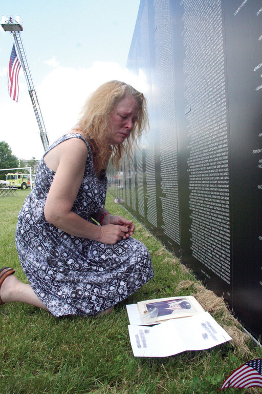REMEMBERING HER UNCLE: Nancy Costello was 10 years old when her uncle, Dennis Morrill of Jamaica Plain, Mass., was killed in Vietnam. She came to see his name, and to remember, Saturday at India Point Park.