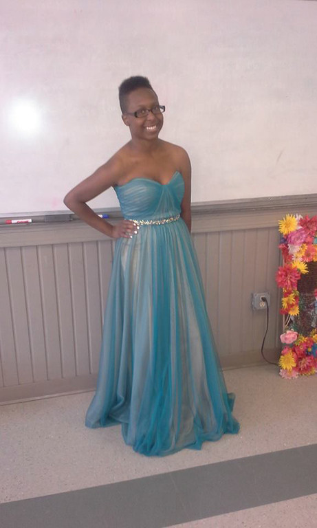 PROM PRINCESS: Senior Jazmine Barron shows off the gown she selected to wear to prom.