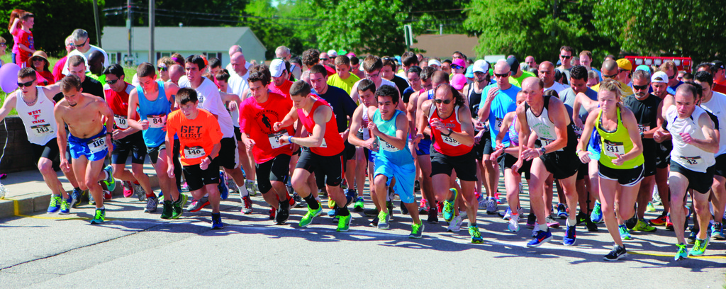 OUT OF THE GATES: Runners break off the starting line in Saturday's Will Speck Memorial 5K at Cranston West. The race, in its 11th installment, drew more than 200 competitors.