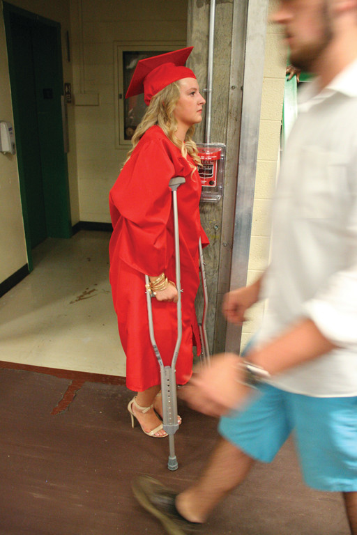 HEELS AND CRUTCHES: Jordan Ethier sports crutches as she prepares to join in the procession of her classmates. In the fall she will attend University of Kentucky.