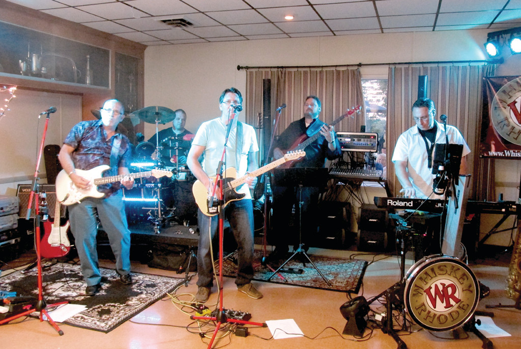 WITH THE OLDIES: A local band named Whiskey Rhode helped make last Friday night's reunion special, as they played songs that were popular back in the 1970s when the Class of 1974 was on its way to graduating from Warwick Veterans Memorial High School on West Shore Road.