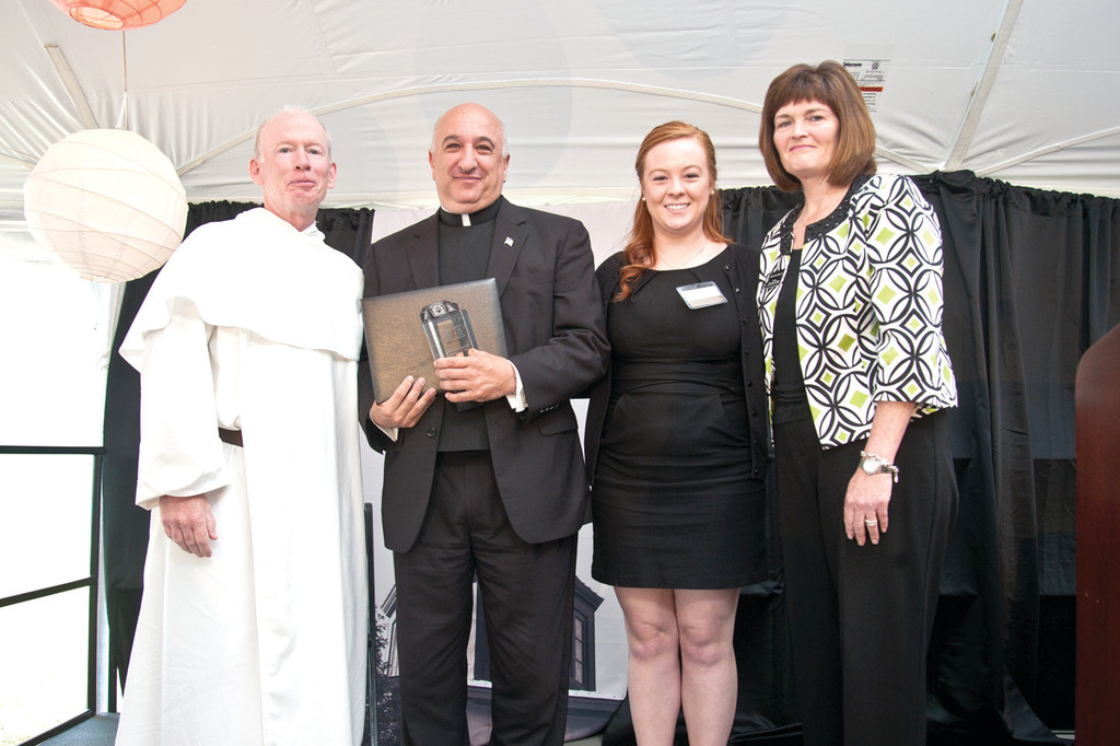 ALUMNI AWARD: President Rev. Brian J. Shanley, O.P., left, is joined by  Rev. Robert Marciano; Meagan Sullivan �14, Student Leader; and Colleen Duffy, President of the National Alumni Association at the PC annual alumni reunion on May 31.