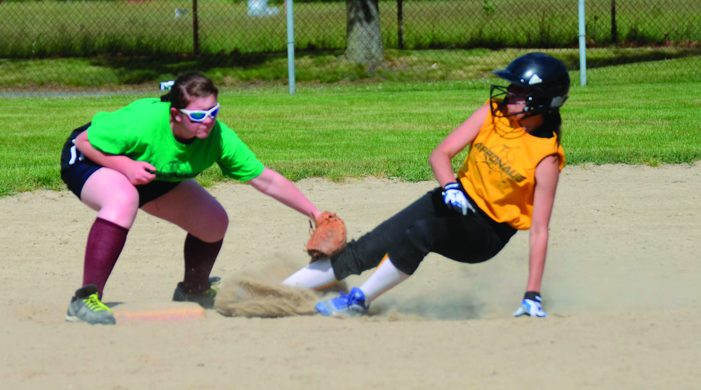 Megan Ursini, left, tags out Deandra Delsignore on a slide into second base.