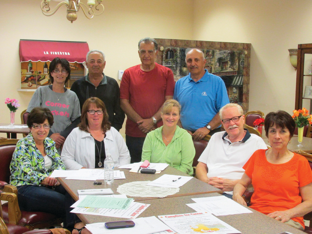 WORKING TOGETHER: Among those people who are planning the June 21 Campfires for Cancer are, seated from left, Pat Quaranta, Linda La Fazia, Robin Christensen, Joe Wells and Karen Wells; and standing from left, Julieanne DeAngelis, Ernie DeAngelis. Dennis Quaranta and Vin La Fazia.