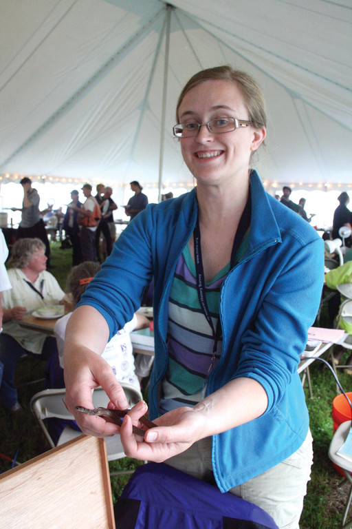 DELIGHTED BY A SNAKE: Molly Allard with a brown snake, one of several species of snake found during the BioBlitz.