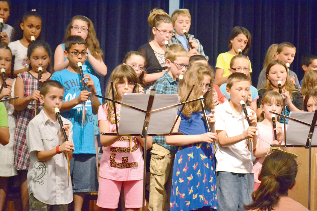 YOUNG PERFORMERS: Third-graders played their recorders at Monday morning�s recital to the school and their families.