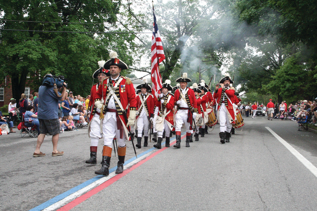 LEADING THE PARADE: The Pawtuxet Rangers with Commanding Officer Ronald Barnes showing the way led off the parade Saturday morning on Narragansett Parkway in Warwick.