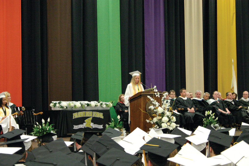 NUMBER ONE: Megan Wilks, valedictorian, speaks to the class of 2014 during Pilgrim�s 52nd commencement last Thursday evening.