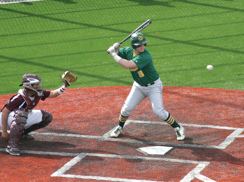 RIVALRY: Above, John Toppa watches a pitch go by during a Hendricken-La Salle game earlier this season.