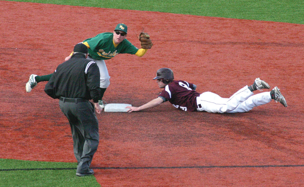 Below, Ryan Rotondo catches the ball while covering second base.