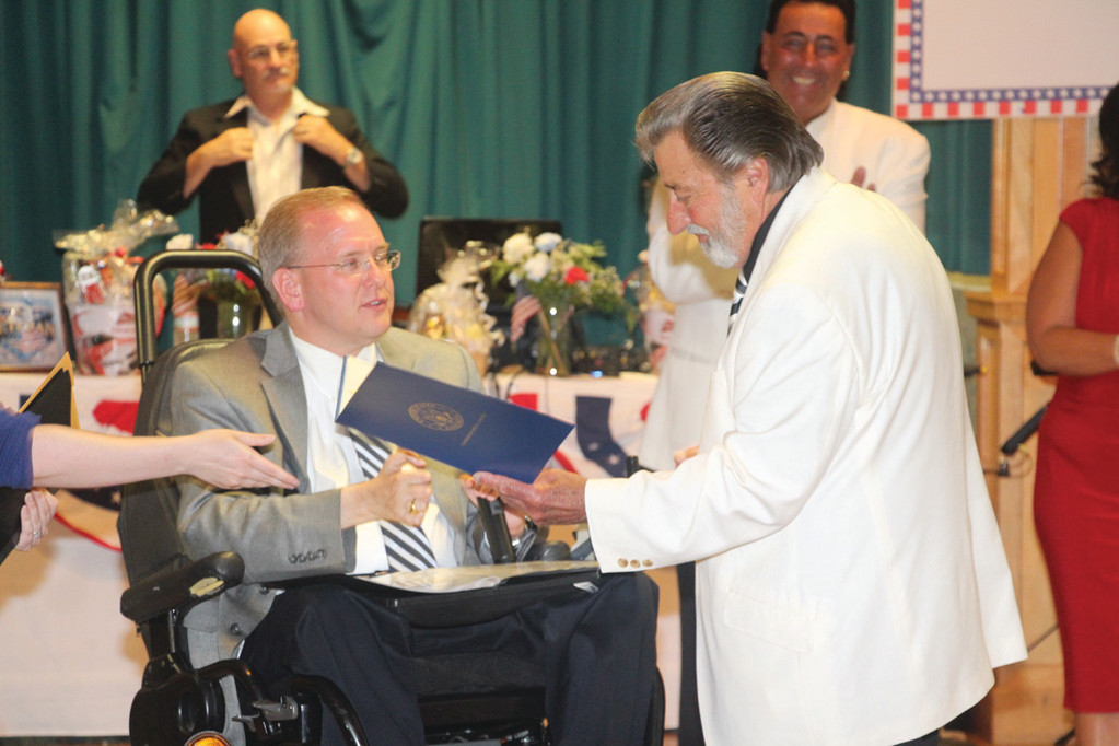 SPECIAL HONOR: Vin Palumbo receives a proclamation from U.S. Rep. James Langevin.