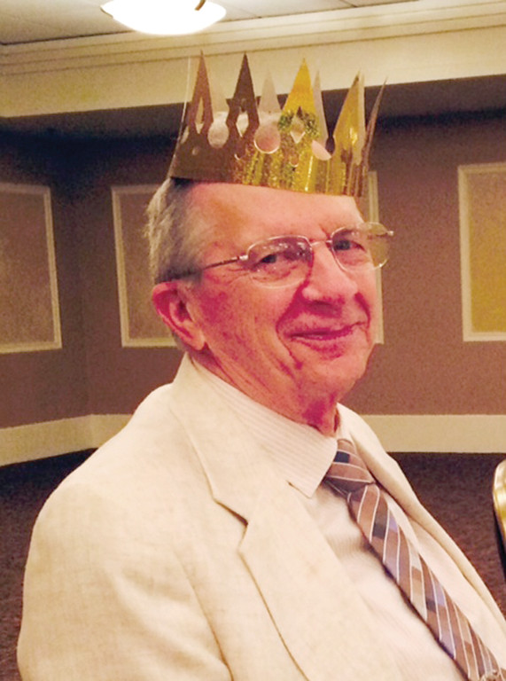 BIRTHDAY KING: Harold �Bud� Barker wears a birthday crown at his 80th surprise party. His family, from all over the east coast, came together to celebrate for the first time in 10 years.