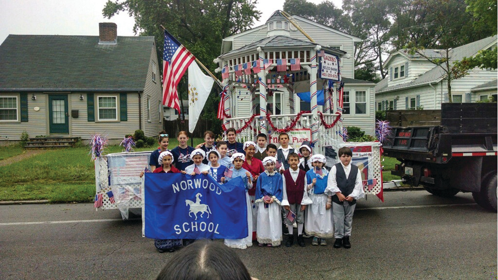 "GASPEE DAYS: The party was not the only surprise for Plumb. Over the weekend the school put together a float in their principal's honor. Students dressed as early revolutionaries walked alongside the float that said, ""Float dedicated to Nancy Plumb for 10 Years of service at Norwood School."""