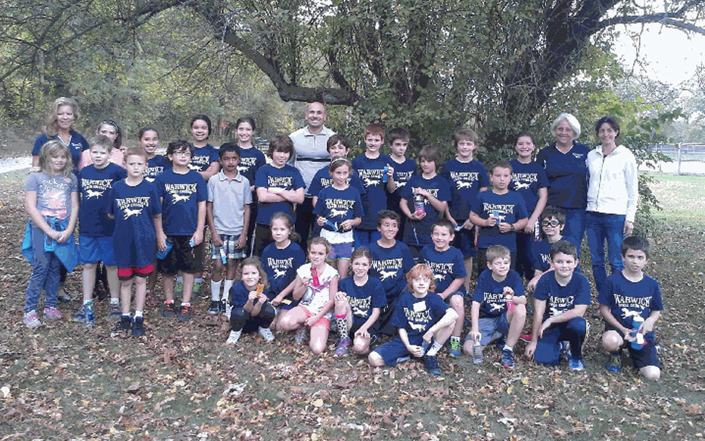 OFF TO THE RACES: Members of the Warwick Wolves pose during the cross country season.