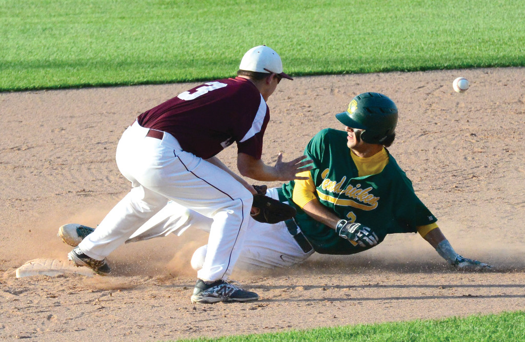 IN THERE: Andrew Ciacciarelli slides safely into second during game two of the state championship series on Wednesday.