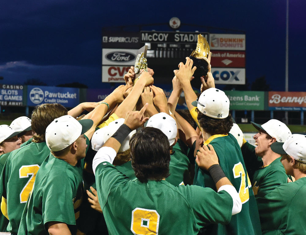 THREE'S COMPANY: Hendricken players celebrate the program's third straight championship on Wednesday at McCoy Stadium. After an extra-inning win in game one, the Hawks were in control in game two, winning 6-0 for the series sweep of La Salle.