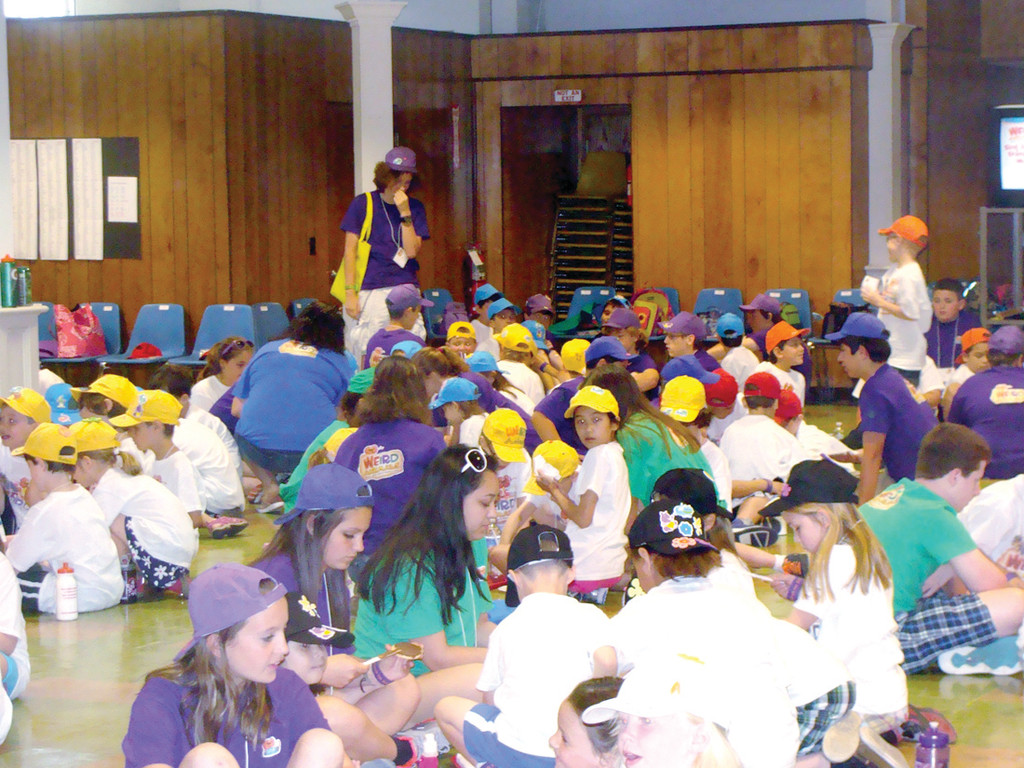 "JESUS LOVES YOU: The campers at St. Peter's Vacation Bible Camp learn five songs throughout the weeklong program that exemplify Jesus and all he has done. Campers, along with their junior and senior counselors in the purple and green shirts, practice the moves to the ""Jesus Loves You"" song. At the end of the week families will be invited to watch a performance from the children of the five songs and dances they learned."