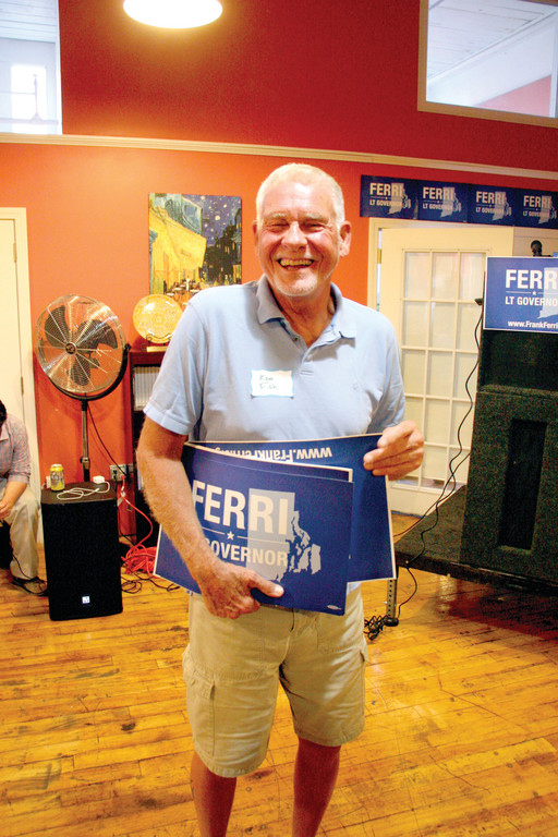 THE GOOD NEIGHBOR: Ken Fish, who lives across from Ferri in the Riverview section of Warwick, passes out posters at Tuesday's announcement.