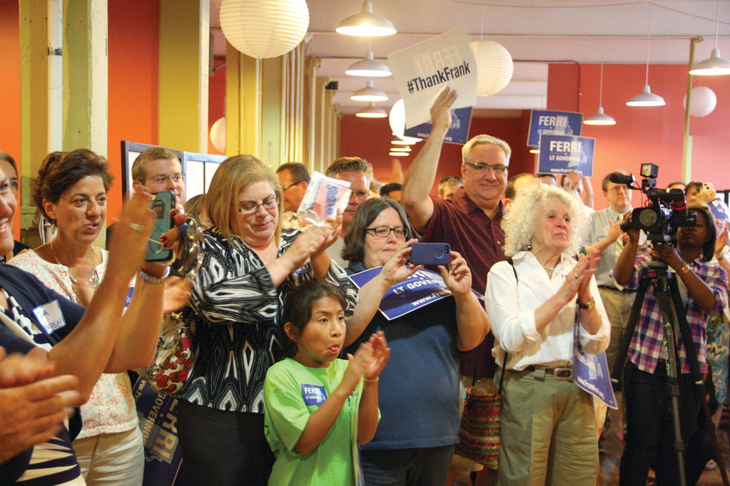 ENTHUSIASTIC SUPPORTERS: Friends, family and colleagues from the General Assembly cheer Ferri's announcement.