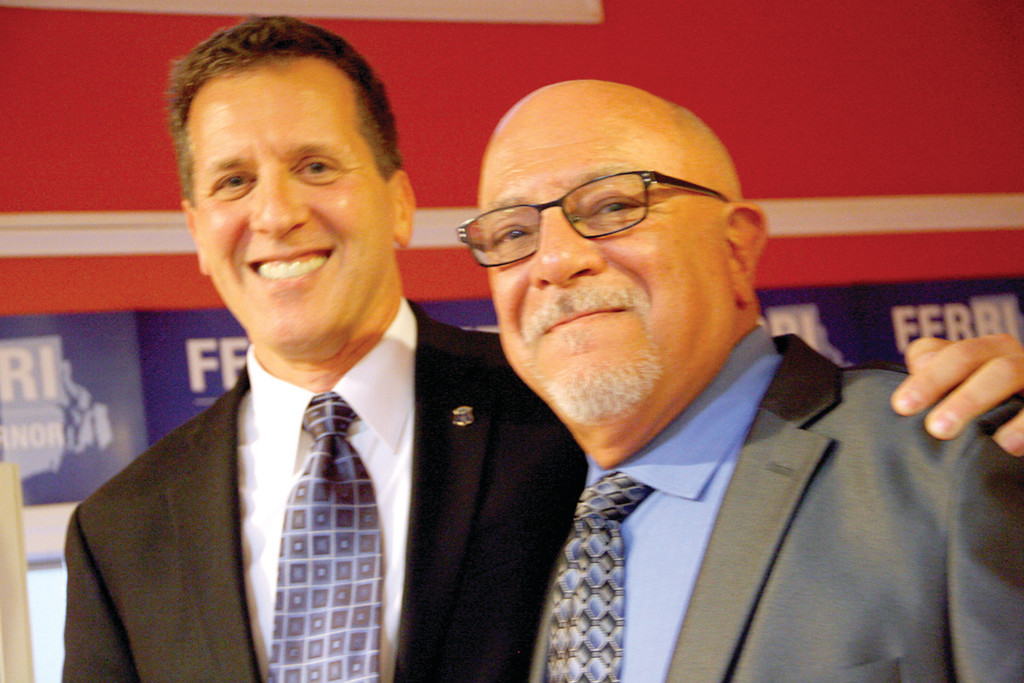 PARTNERS: Ferri and his husband, Tony Caparco, share the spotlight at Tuesday's announcement.
