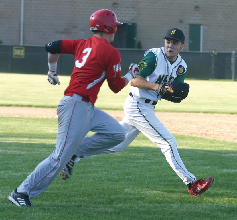 Ryan Charette goes to tag Senerchia's Rob Henry.