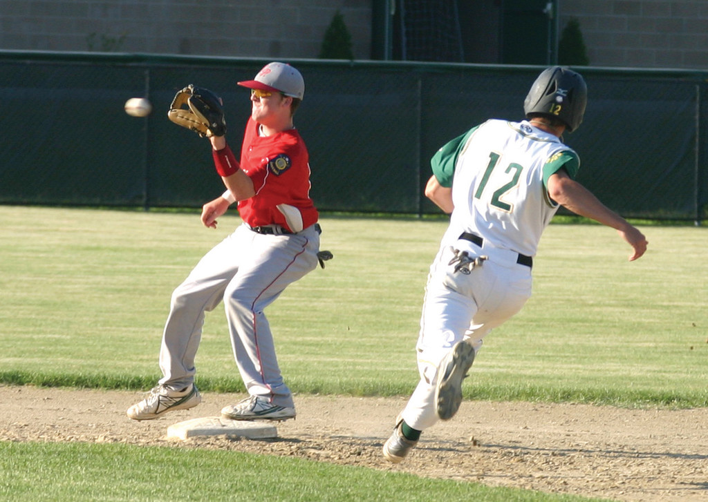BEARING DOWN: Senerchia's Mike Webb catches a throw at second as Ben Mann heads for the bag.