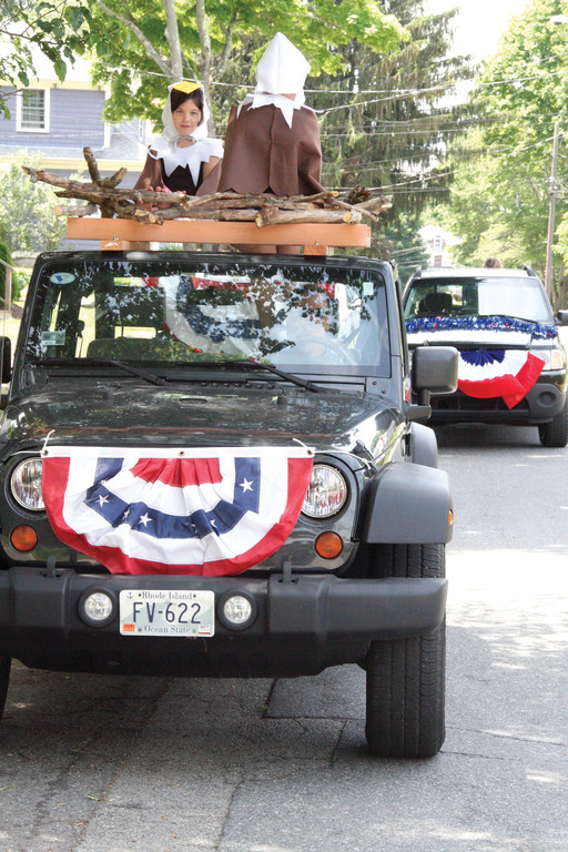 STRAIGHT FROM THE NEST: Sisters Georgia and Greta Shuster were dressed as bald eagles as they nested on top of their father's jeep for the parade. And you might catch them again in the July 4 Warwick Neck parade…only, as Greta pointed out, they will have feathers by then.