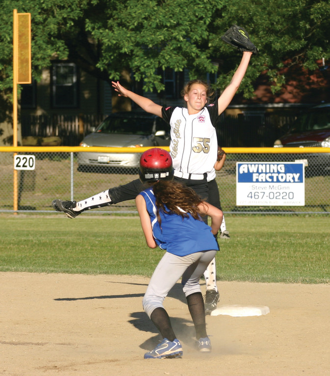FULL EXTENSION: West Side shortstop Lexi Brown makes a leaping grab of a throw to second as a South Kingstown runner tries to steal the base.