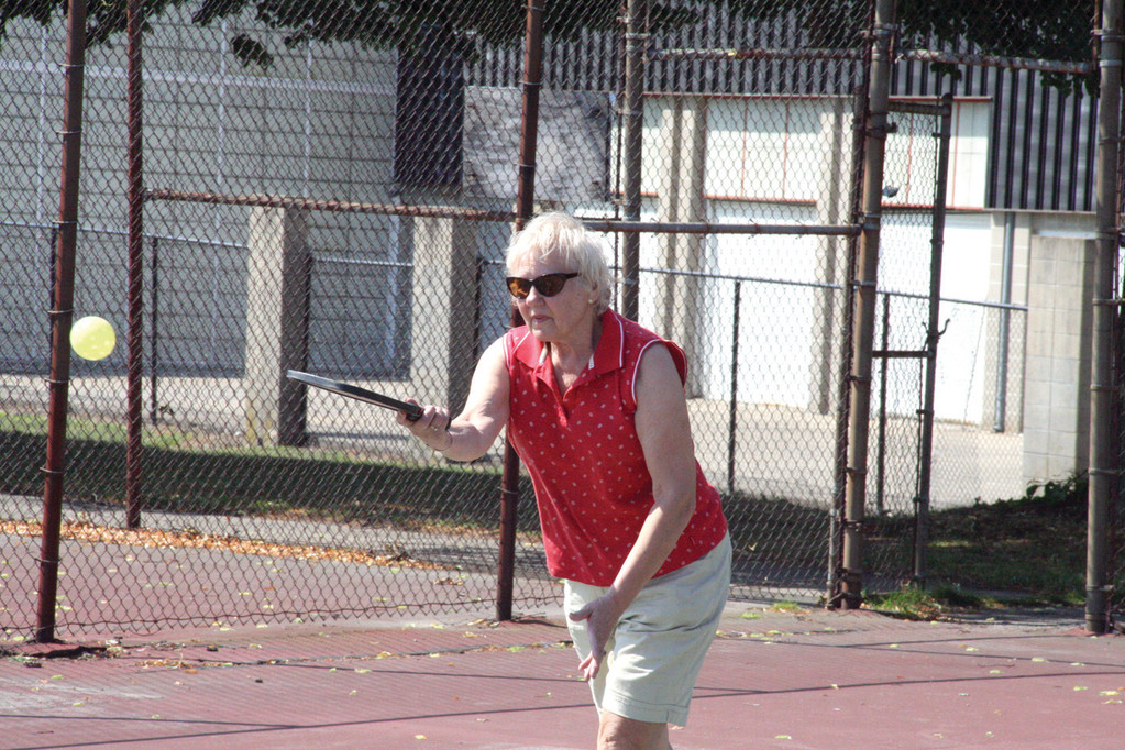 SERVING IT UP: June Langevin goes for a point.