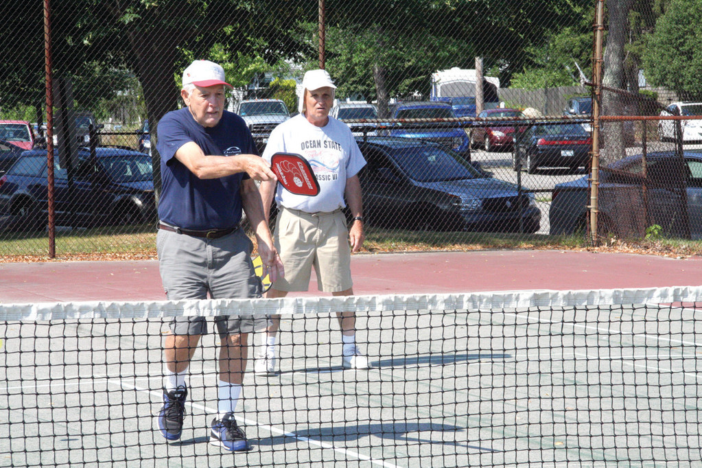 NET GAME: Arthur Sulmasy and Ted Weller team up for a game of doubles.
